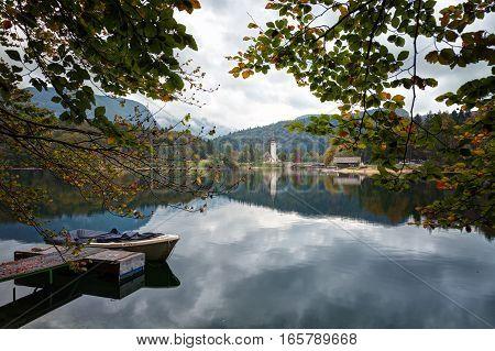 Slovenia boat on Lake Bohinj in the background the church and stone bridge