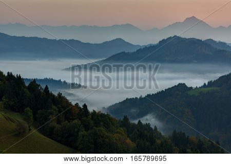 Slovenia Morning landscape with fog in the mountains