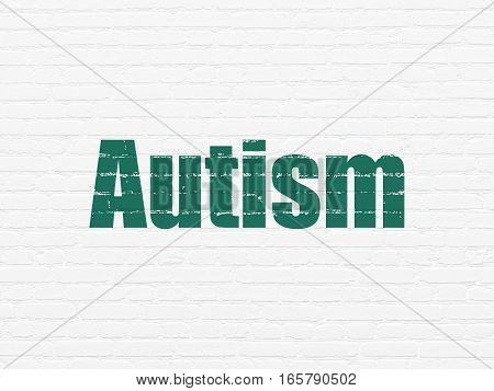 Healthcare concept: Painted green text Autism on White Brick wall background