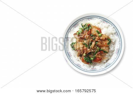 Fried crispy barbecue pork with basil leaves and chilly and egg over white steamed rice thai food on white background .