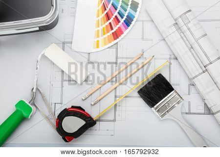 High Angle View Of Blueprint With Tools And Equipment On Desk In Office