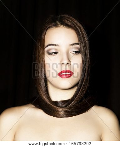 beautiful young caucasian woman portrait on black background.
