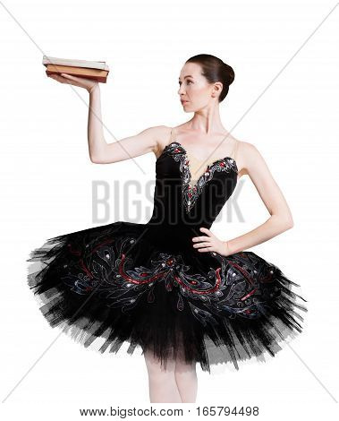 Graceful ballerina with book for training ballet posture isolated on white background, isolated. Professional dancer in black tutu skirt. Choreography classes concept