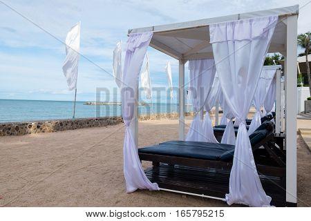Simple beach pavilion on the beach sea view