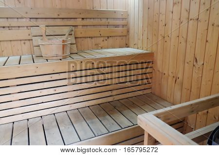 Modern Wooden sauna with stone oven, empty sauna