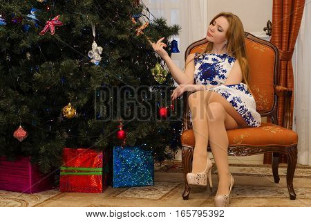 sexy woman sitting on chair with legs crossed