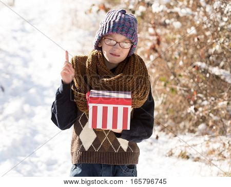 Small Boy With Present Box In Winter Outdoor