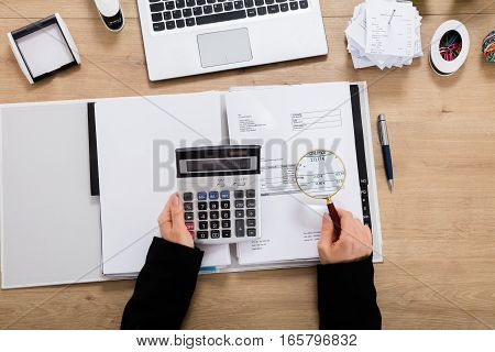 Auditor Checking Invoice Using Magnifying Glass. Tax Fraud Investigation Concept