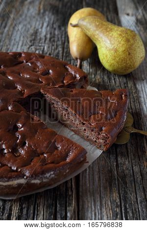 Chocolate pear cake and two yellow pears