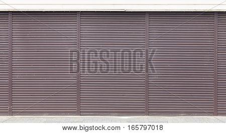 Brown metal shutter door as pattern and background