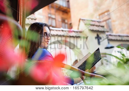 Woman At The Cafe