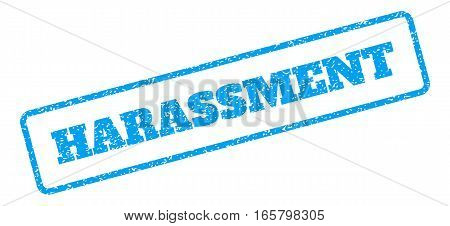 Blue rubber seal stamp with Harassment text. Vector message inside rounded rectangular frame. Grunge design and scratched texture for watermark labels. Inclined emblem on a white background.