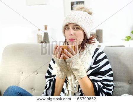 pretty young woman drinking a cup of tea