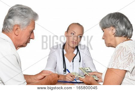 Portrait of a female doctor with patients accept money