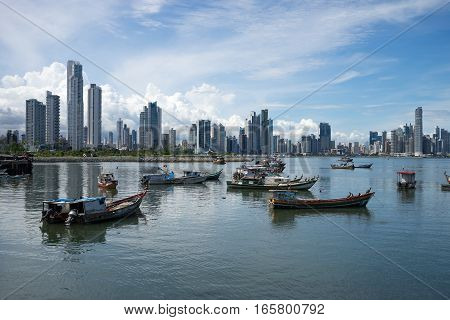 June 15, 2016 Panama City, Panama: small fishing boats floating on the water with the modern downtown high-rises in the background