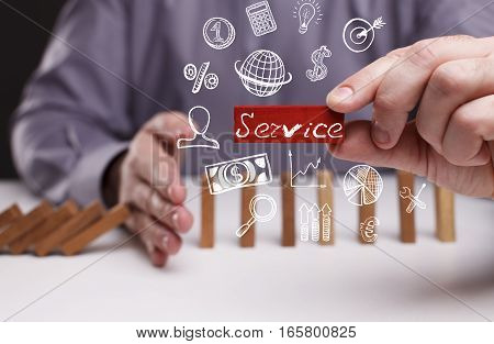 Business, Technology, Internet And Network Concept. Young Businessman Shows The Word: Service