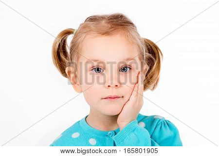 Closeup Thoughtful Cute little Young girl Looking Up with Hand at Face isolated white background sign and gesture concept
