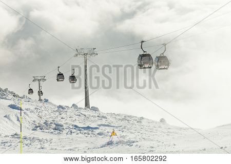 CHOPOK SLOVAKIA - JANUARY 12 2017: Cable car cabins going up and down at a winter sports resort area on January 12 2016 - Slovakia
