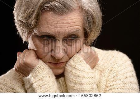 Portrait of a upset mature woman, close up