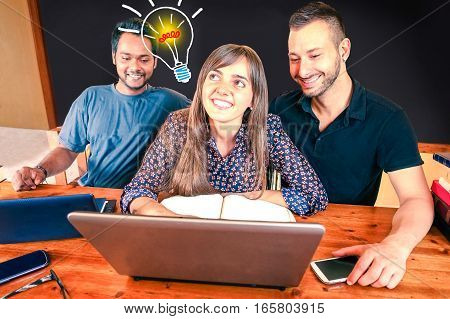 Multiracial creative team with lightbulb of fresh ideas coming up - Inspired multicultural friends working together at solution using pc - Brainstorm concept - Blackboard background for copy space