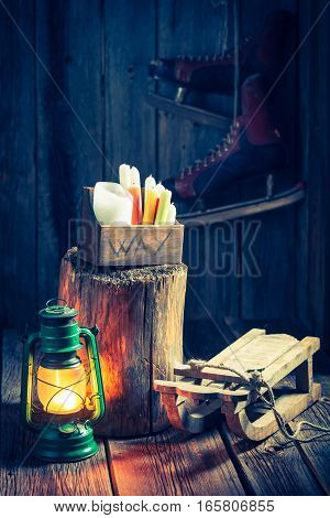 Retro Winter Cottage With Snow And Oil Lamp