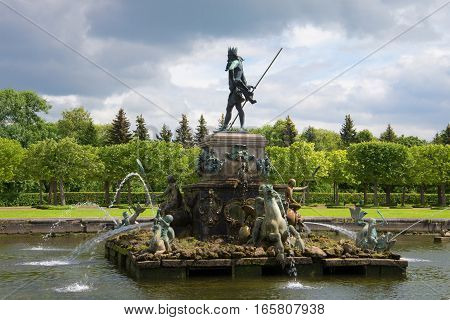 SAINT PETERSBURG, RUSSIA - JULY 02, 2014: The fountain the Neptune in the Top park of a palace complex in the cloudy July afternoon. Peterhof