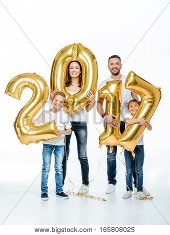 Happy family holding golden balloons in hands