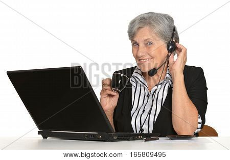 Portrait of a mature woman using laptop wearing headphones