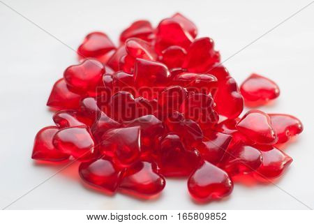 Valentine's day, a bunch of candy in heart shaped small red candy on white background, Concept of Love