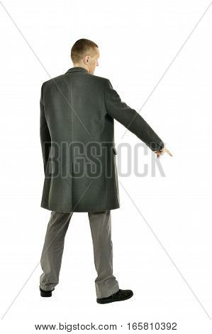 Handsome Man in coat pointing down on a white background, back view