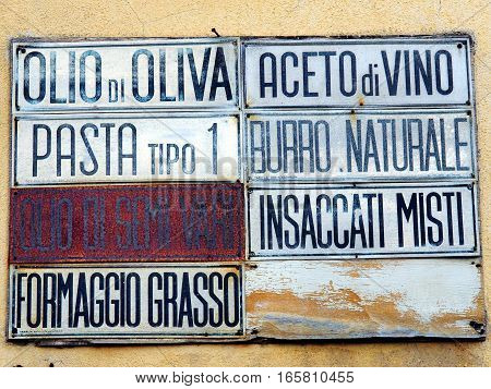 Old italian sign hanging on a wall