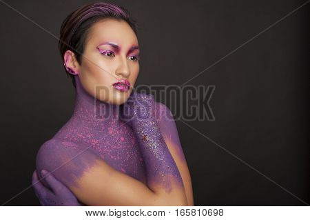 Fantasy violet make up, beautiful asian model, woman portrait