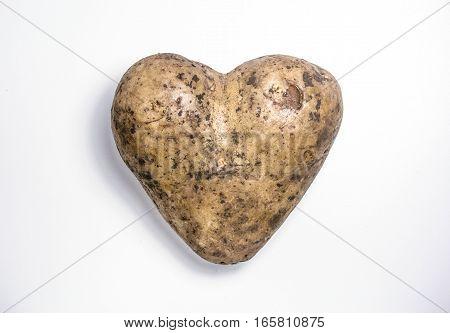 Happy valentine's day potato. Heart on white background
