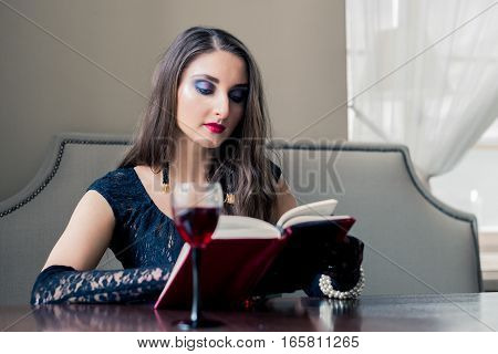 beautiful girl in a coffee shop reading a book