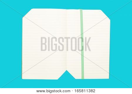 Note book on blue background isolated useful for business education concepts