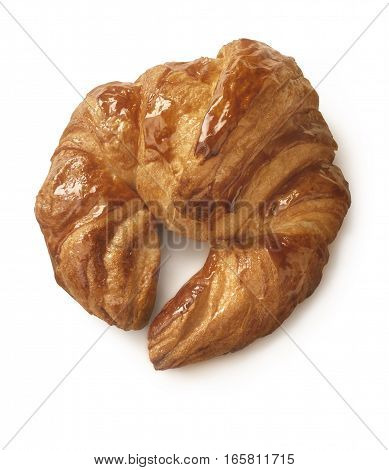 Fresh and tasty croissant polished with syrup. Cliping path on pastry.