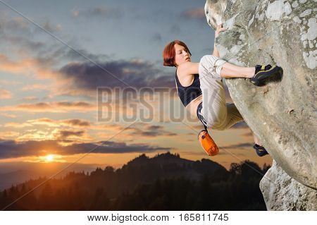 Female Climber Climbing Without Rope On A Rocky Wall