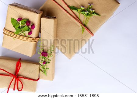 craft cardboard gift boxes with flowers on  white background