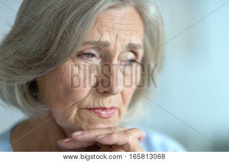 Portrait of a upset senior woman, close up
