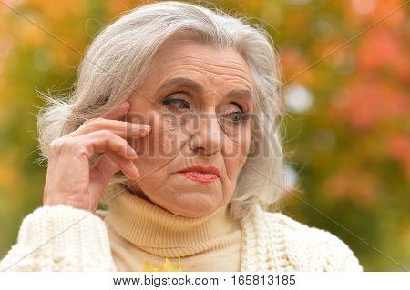 beautiful mature woman, upset, close up portrait