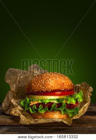 Close-up Homemade Burger On Wooden Table On Green Background