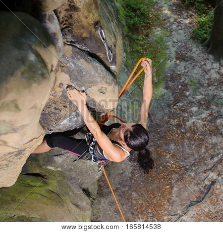Female Climber Climbing Big Boulder In Nature With Rope