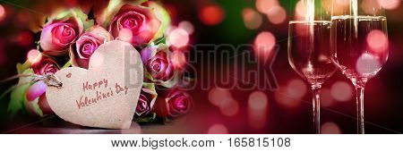 Happy valentines day with a bouquet of roses and champagne for a greeting card