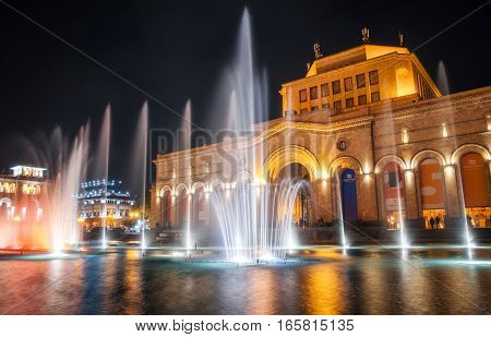 Yerevan Armenia. September 10 2016: The colored singing musical dancing fountains against the building of the National Gallery and History Museum of Armenia