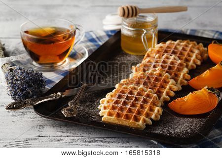 Brussels waffles on the vintage tray and cup of tea