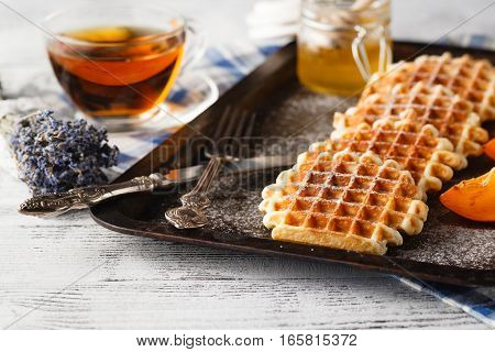 Brussels waffles on the old dark tray