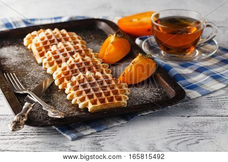 Pile Brussels waffles on the vintage tray