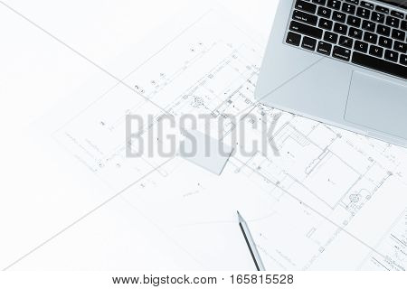 Pen, And Notebook Over House Construction Blueprint With Blue Tone Effect