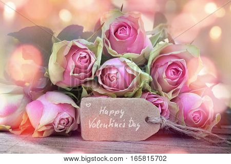 Greeting card with pastel colored roses and bokeh for Valentines Day