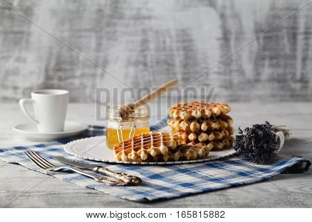 Homemade wafers on plate for breakfast with honey